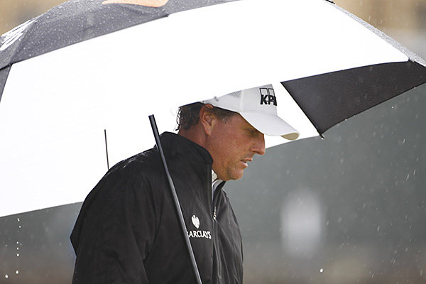 Mickelson played through a few early morning showers, but scoring conditions were tougher in the afternoon after the winds kicked up.