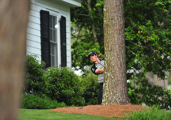 Trying to become the second youngest player to win the Masters, McIlroy's four-shot lead at the start of the day quickly vanished, but he still went into the back nine tied for the lead. Then McIlroy tripled No. 10, four-putted for double bogey on No. 12, and when his tee shot found Rae's Creek on 13, his hopes for a green jacket were over.