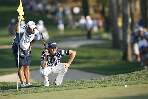 missed a 20-foot par putt on the 18th hole that would have forced a playoff with Woodland.