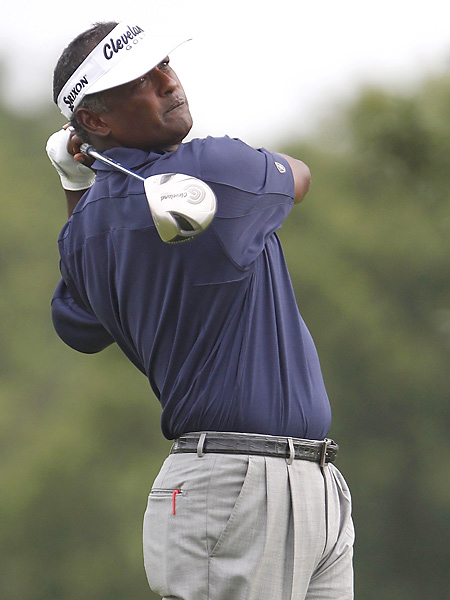 Vijay Singh shot a six-under 65 and trails the leaders by one shot.