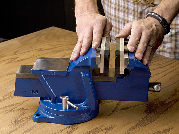 Step 2 Place the rubber pads in your vise. This is important—you can easily bend the shaft with even the slightest pressure from the vise.