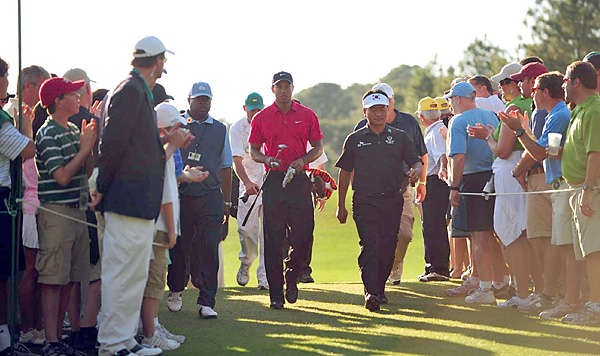 After a tumultuous, tabloid-filled offseason, Woods kicked off his 2010 season at the Masters (left), where he finished tied for fourth. He went on to finish winless on the year, a first for his professional career.