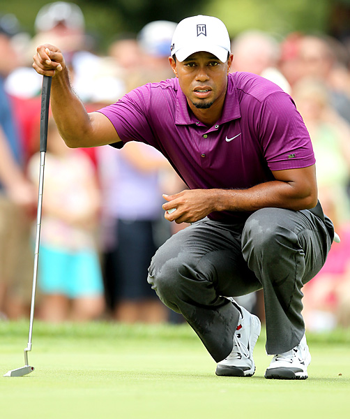 Woods sported a pair of Nike prototype golf shoes during his opening round.