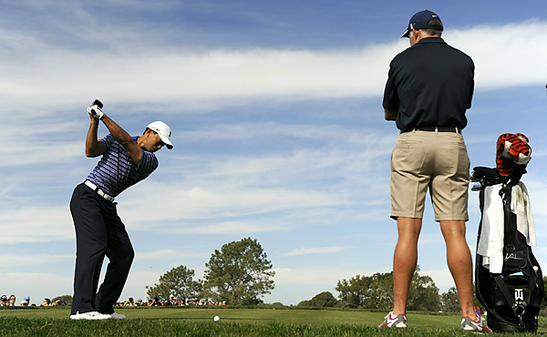 Tiger Woods teed off on No. 14 under the watchful eye of his caddie Steve Williams.
