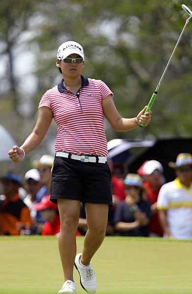 Yani Tseng shot a final-round 66 to beat Wie by five shots and earn her third win in her last three events.
