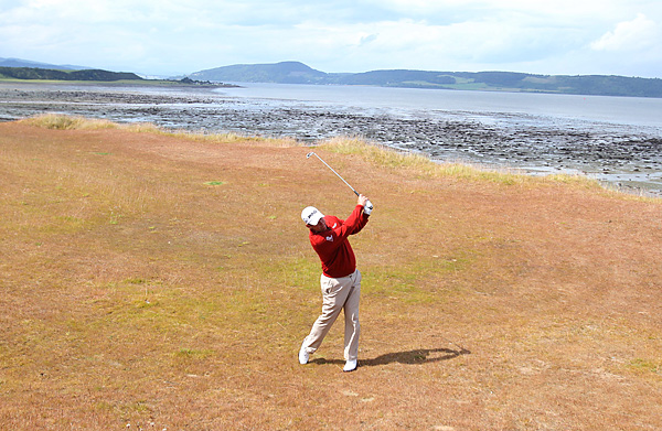 shot a 65 to share the lead at Castle Stuart.