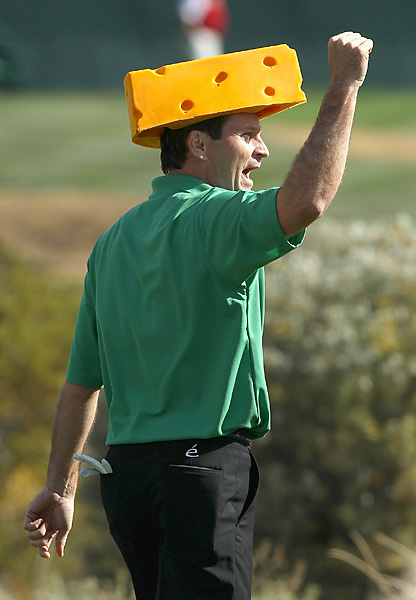 Wilson brought out a cheese head after teeing off on the 16th hole in his third round.