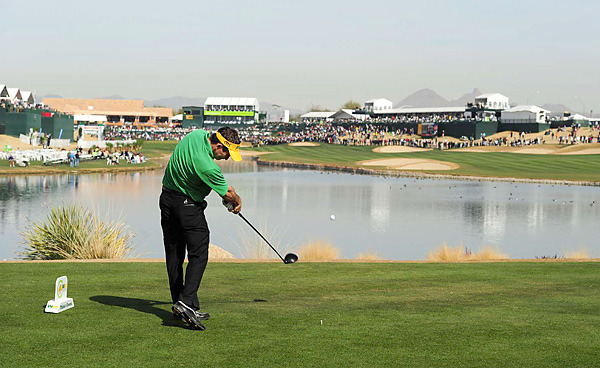 Mark Wilson surged to a two-shot lead in the darkness-shortened fourth round while sporting the colors of his beloved Green Bay Packers on Super Bowl Sunday.