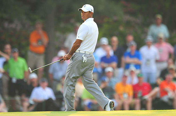 Woods nearly walked in an eagle putt on No. 15. Instead, he birdied — his third in a row.