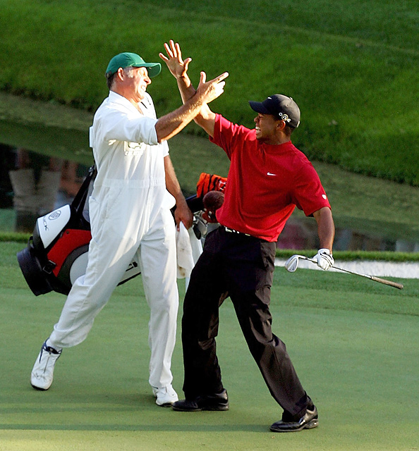 Awkward high-five at 2005 Masters In the final round of the 2005 Masters, Woods made one of the greatest shots of his career when he chipped in on the 16th hole and went on to win his fourth green jacket. But after the ball dropped into the hole, Woods and Williams shared what might be one of the worst high-fives in the history of sports.