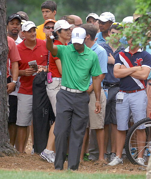 Woods had a short week at the Wells Fargo Championship in May. He received a free drop when his ball mysteriously disappeared in the crowd on the fifth hole during his second round, but the generous ruling didn't matter. Woods shot 71-73 and missed the cut.