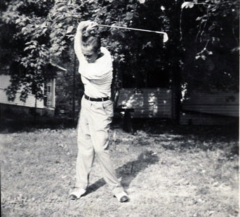 "Here's my dad practicing ""Swing Number 23-B"" in one of our many back yards. The Garrity photo album looked like something you'd take home from the David Leadbetter Academy -- snapshot after snapshot of Dad and Tommy, my golf-prodigy brother, swinging in driveways, in parks, at driving ranges and -- minus the club -- in living rooms."