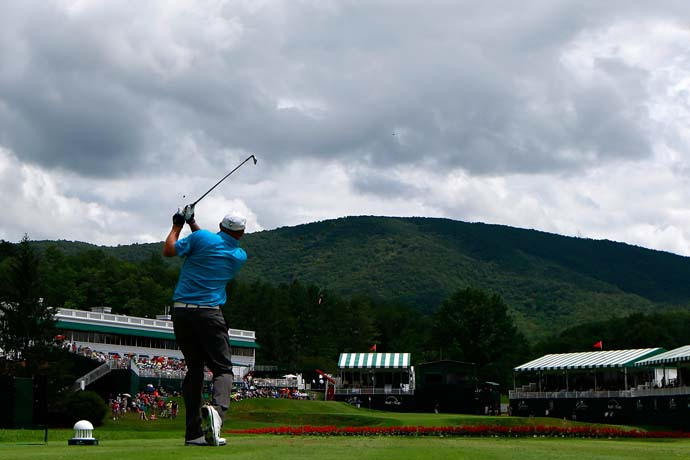 Two Gloves hits his tee shot in 18 at Greenbrier. Gainey is in the field this week because Tiger Woods withdrew due to his injured left elbow.