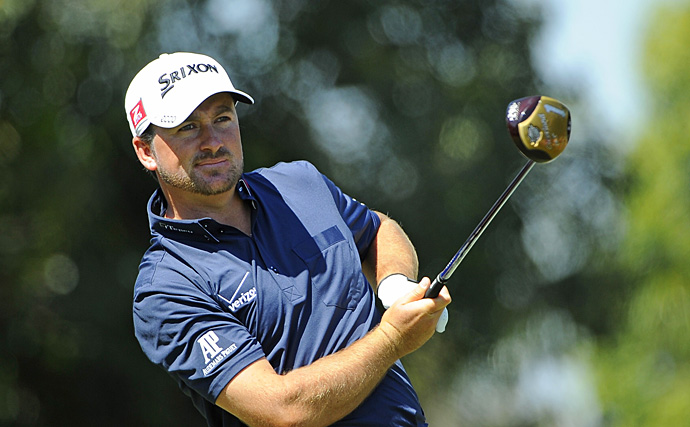 Graeme McDowell will be in the final group with Woods on Saturday.