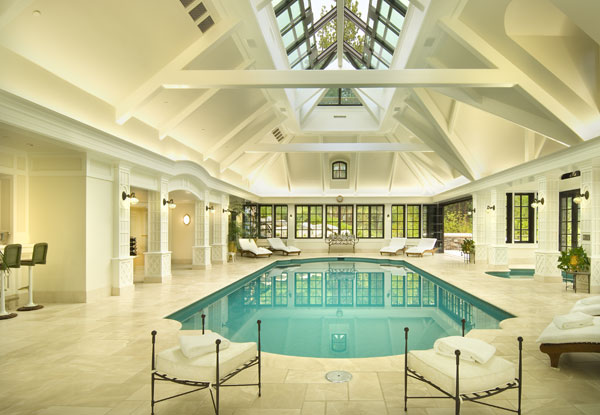 There is also a conservatory, accessed by an underground passage, which features an indoor swimming pool and spa, poolside bar and exercise facilities.