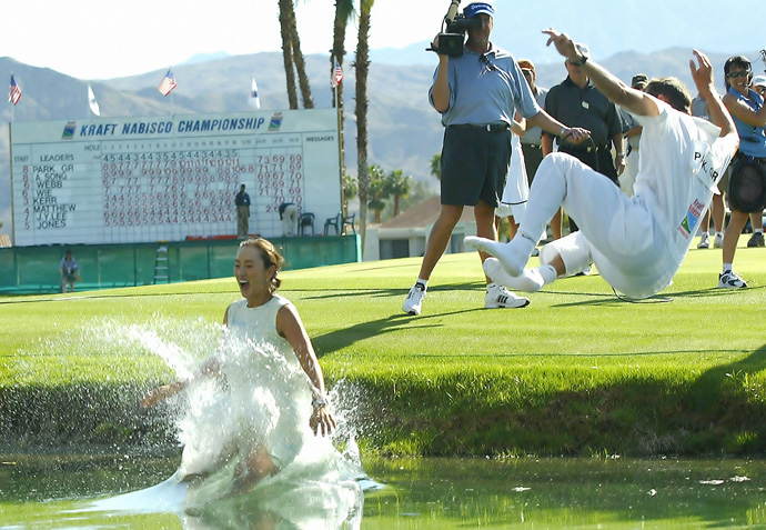 Grace Park, and her caddie, Dave Brooker, celebrated her first major championship with a dive in the pond.