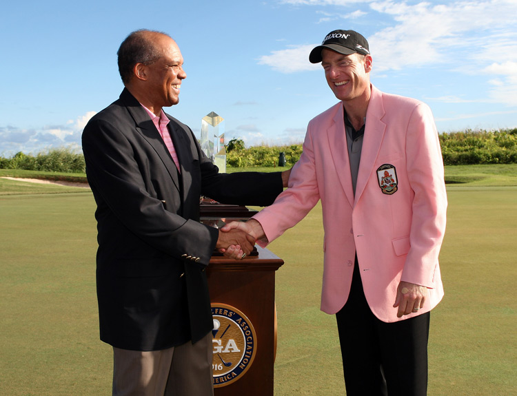 The PGA Grand Slam of Golf winner gets a jacket that's right at home in Bermuda. Jim Furyk won there in 2008.