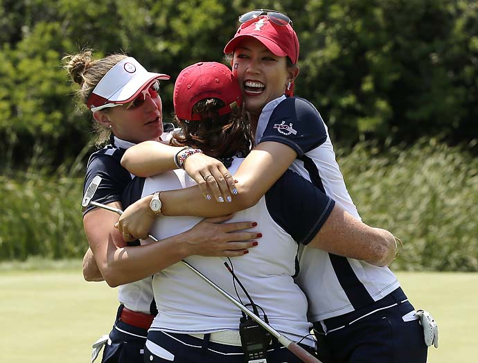 Michelle Wie, Brittany Lang and U.S. captain Meg Mallon celebrate Wie and Lang's Saturday morning win over Beatriz Recari and Suzann Pettersen.