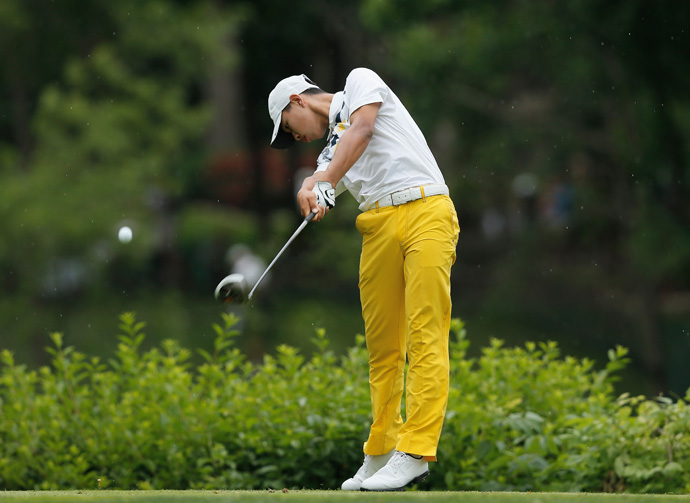 Guan Tianlang, 14, missed the cut after rounds of 72-79.