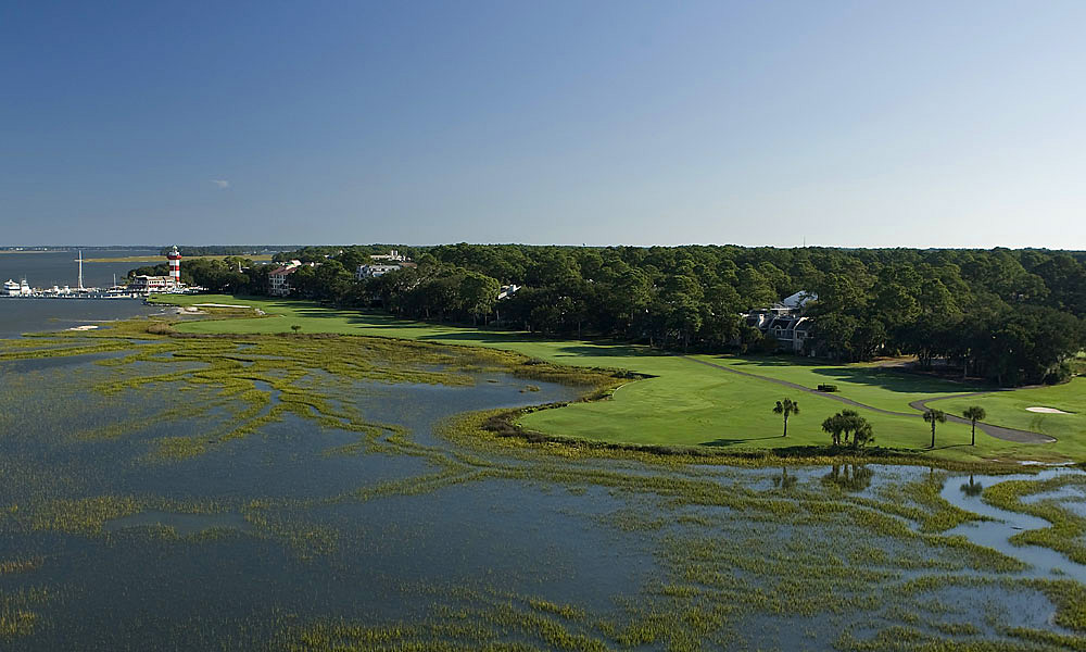 10. Harbour Town Golf Links -- No. 18: Par 4, 472 yards -- Hilton Head Island, S.C.                     How great can a short, flat course mostly hemmed in by live oaks be? Check out Harbour Town and find out why the pros are so enamored with it. Pete Dye and consultant Jack Nicklaus hatched a somewhat claustrophobic layout that zigzags among oaks and lagoons, a design that favors no single type of player except skilled shotmakers. It all concludes with a muscular two-shotter. To the left is the Calibogue Sound. To the right lies trees, condos and out-of-bounds. In the distance looms Harbour Town's most enduring symbol, a candy cane-striped lighthouse, along with a marina filled with boats owned by the kind of people who can afford to play Harbour Town every day. It's a hole so iconic, it has to be played.