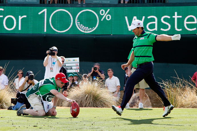 Padraig Harrington won over the crowd when he kicked a football into the stands.