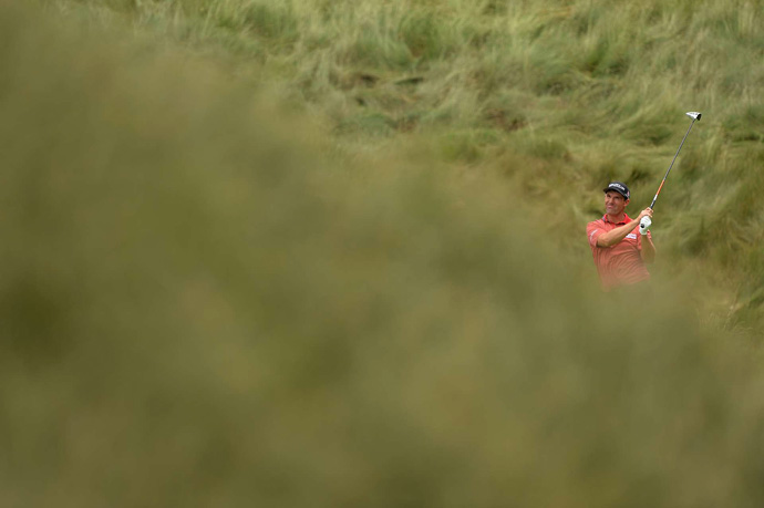 Padraig Harrington made a double bogey, three bogeys and two birdies for a 73.