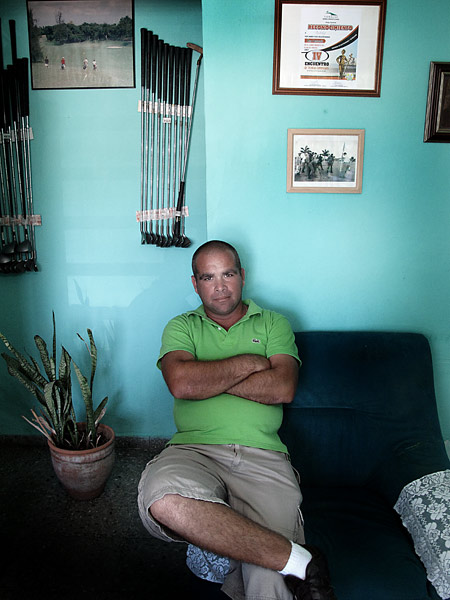 Johan Vega, an 8 handicap, is the head pro at Havana Golf Club. The clubs on the wall of his shop have gone unsold for 20 years. Above and to the right of Mr. Vega is a photograph of the infamous match between Fidel Castro and Che Guevara. The match was ugly, but in the end Che won, and the sore Castro destroyed most of the golf courses in Cuba in anger.