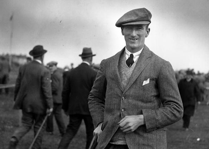 British golfer Arthur Havers, winner of the 1923 Open at Troon, epitomized the early 20th century look: tailored tweed jacket, V-neck sweater, wool cap, and necktie. Note the pinned collar and carefully arranged points on his pocket square -- a level of elegance lost in time.