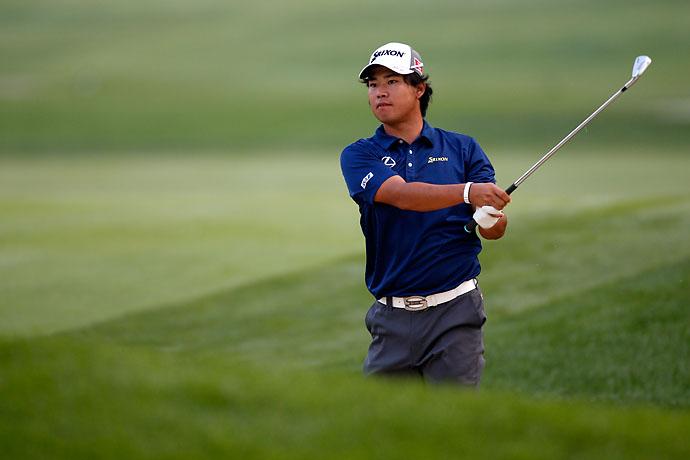 Hideki Matsuyama plays a shot on the 14th hole during the third round of the Bridgestone Invitational.