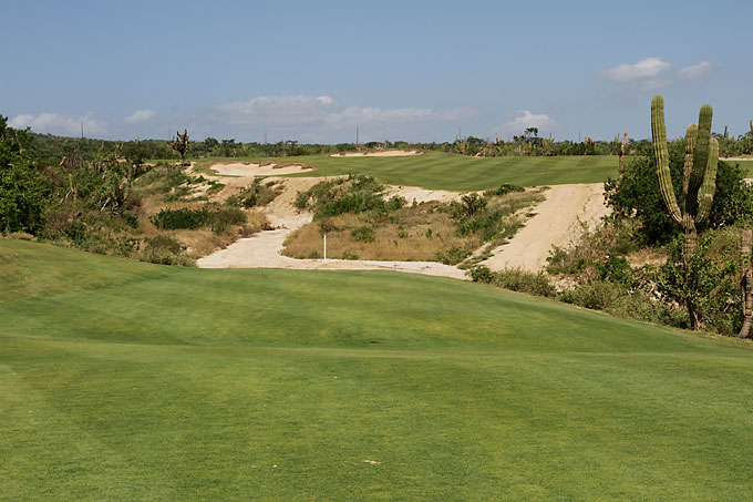 12th Hole: The uphill 405-yard, par-4 12th doglegs to the left up a slope to a plateau fairway. The small, 4,500-square-foot green features a false front that will repel any timid second shot.