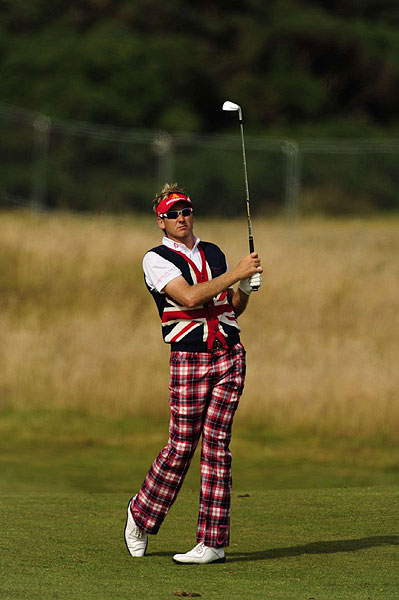 Not to be out done, Ian Poulter wore his Union Jack pride on his sweater vest.