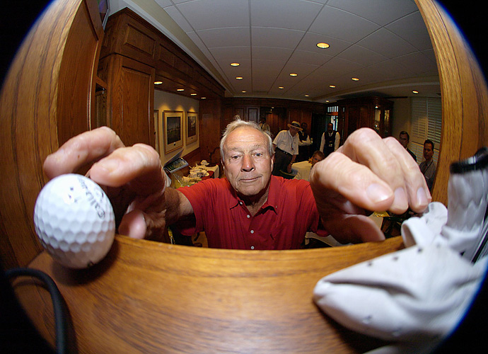 Four-time champ Arnold Palmer shelved his ball and glove after his 50th consecutive and final Masters appearance in 2004.