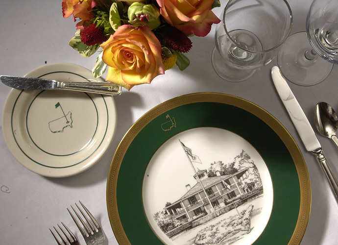 Customized china with images of the clubhouse and the club logo decorate the tables in the main dining room.