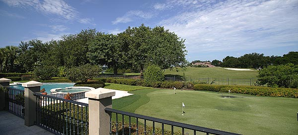 The estate, which includes a putting green and golf club storage room, has a great view of the sixth hole at the Isleworth Country Club.