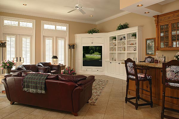 The family room features a full bar. There is also a media room with gas fireplace.