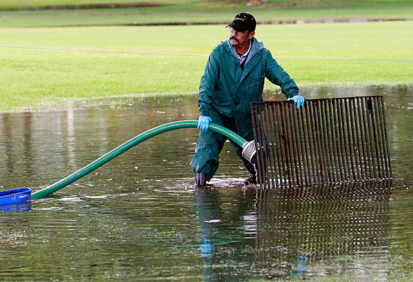 Maintenance crews were hard at work all day doing their best to clear the course of water.