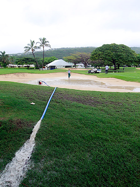 Standing water was common throughout the course on Thursday, including in sand traps and fairways.