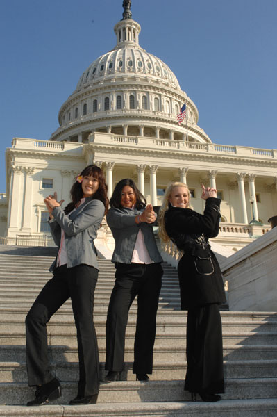 Michelle Wie, Christina Kim and Natalie Gulbis strike a pose during their visit to the nation's capital with the winning U.S. Solheim Cup.