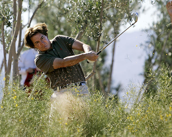 Actor Kyle MacLachlan lashed out from behind a bush on the first hole.