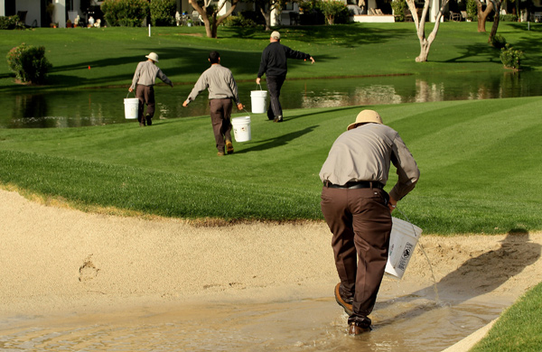 Workers were still bailing water out of bunkers Friday morning after several inches of rain fell on Thursday.