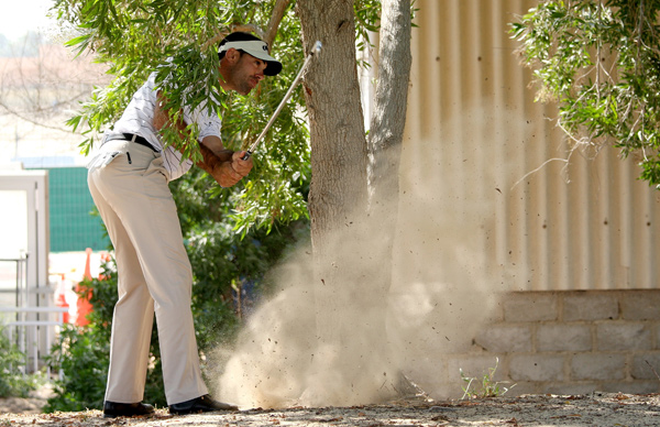 is only three shots off the lead, despite having to play a shot left handed on the fifth hole.