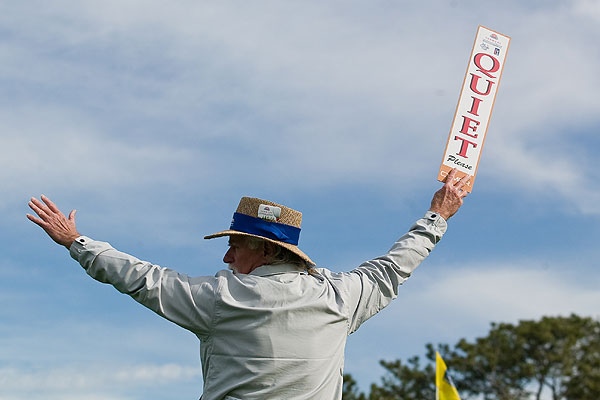 A course marshal holds up the quiet sign during the second round at Torrey Pines.