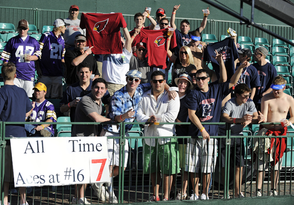 Fans at the rowdy par-3 16th were out early to grab a good seat.
