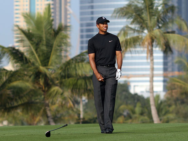 Woods tossed his club after sending his second shot on No. 13 into the water.