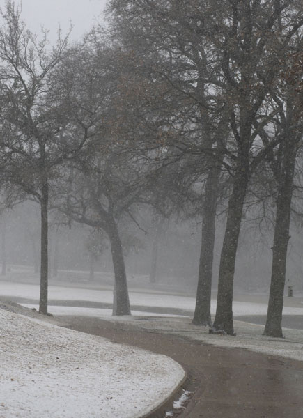 A golf course in Mansfield, Texas was coated in the white stuff as much of the country experienced colder-than-usual conditions.