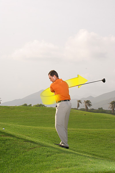 POWER DRILL                                          HOW TO GET IT: Make practice swings on a sidehill lie with an imaginary ball above your feet. You can do this next to any elevated tee box while waiting for your turn to hit. Swinging from this lie combats a steep downswing, because if you swing over the top your club will slam into the hill. Focus on swinging around your body rather than up and down, and try to brush the grass where the ball would be in your stance. If you can't find a sidehill, make baseball swings by moving the club back and through at waist-height.                     Your swing plane automatically flattens when the ball is above your feet...