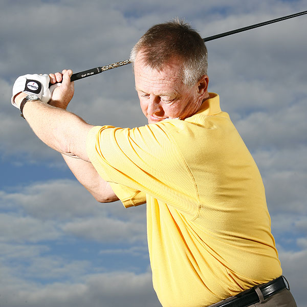 How To Gain 15 Yards                       Rotate your shoulder into your chin, not under it                                              By Martin Hall                       Top 100 Teacher                                              This story is for you if...                       • You need some more yards off the tee.                       • Every time you swing for the fences,                       you pop the ball up.                                              Try This!                       On the practice tee (or                       while making mock swings                       in your backyard), place                       a dollop of shaving cream                       on the left side of your                       chin. Make your regular                       backswing and hold your                       top position for a count,                       relax, then check your                       left shoulder. Is it clean or                       covered in shaving cream?