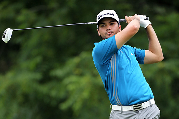 Jason Day also shot 65. He's tied for third with Westwood and Robert Garrigus at five under.