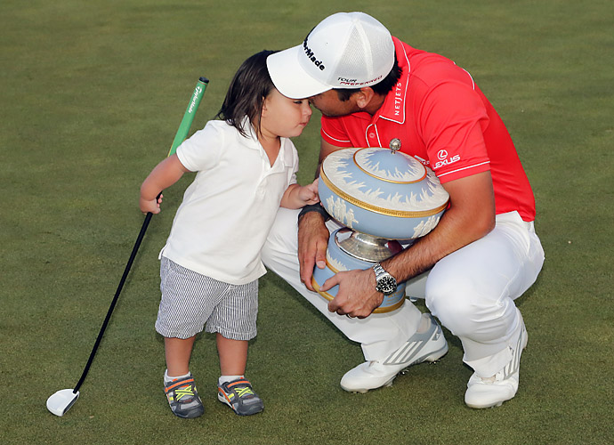 Day celebrates his victory with his son, Dash.