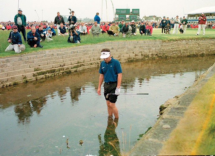 "Has there ever been a more pathetic looking figure in golf than Van de Velde ankle deep in the Barry Burn at Carnoustie's 18th hole? Oft-forgotten, sadly, was the sensational golf he had played over ""Car-Nasty,"" one of the fiercest championship tests ever. Had his 2-iron not hit a gallery railing, he might have been immortalized as an Open Champion. Instead, eternal nightmare."